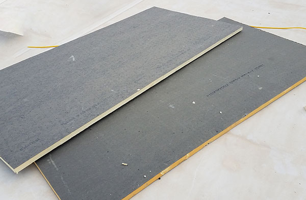 Used polyisocyanurate foam board panels reclaimed for reuse.