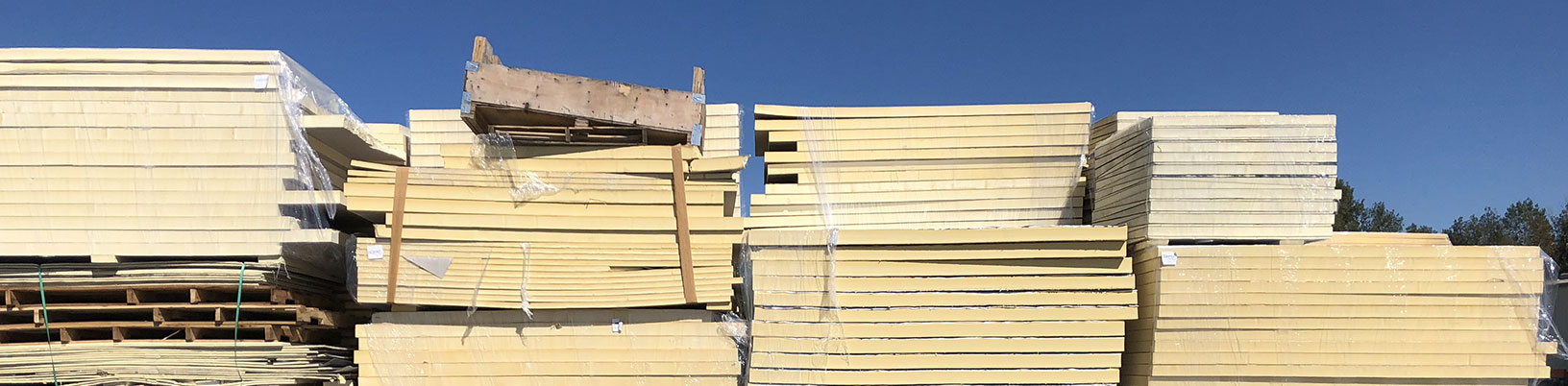Stacks of used foam insulation boards ready for reuse